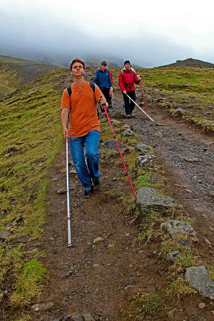 World Access for the Blind Founder and President Daniel Kish leading hikers along a mountain pass. Photo provided by: Daniel Kish