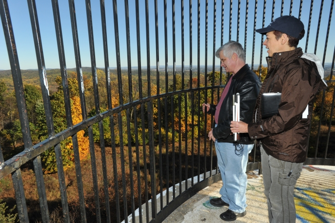 Brad Barrows and reporter Katherine Jurgens atop the Observation Tower at Clarence Schock Memorial Park near Harrisburg, Pennsylvania. Photo by: Frans Jurgens