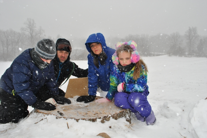 A Hamden family braved a winter storm to speak up for the felled tree. John and Christina Sagnella, with their children, Jack, 10 and Hannah, 8.